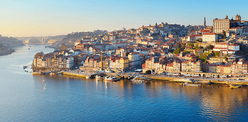 Portugal, Porto - Douro River With Oporto City in the Background